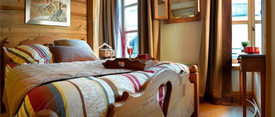 The bedroom of the apartment - Le Savoy in Argentière